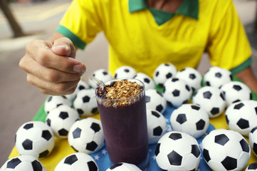 Brazilian Soccer Player Eating Acai with Footballs
