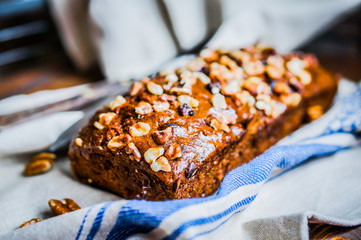 Homemade nut cake on wooden background