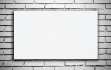 White boards on white brick wall.
