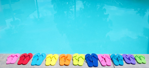 Color flip flops by the pool