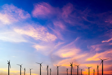 wind turbine silhouette on colorful sunset