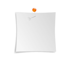 White sheet of paper pinned with orange pin to the wall