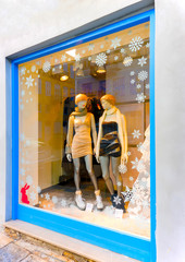 Christmas decorated vitrine with 2 dolls in Nafplio town Greece