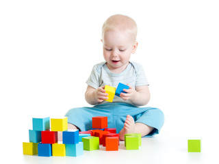 Child boy playing toy blocks isolated on white background