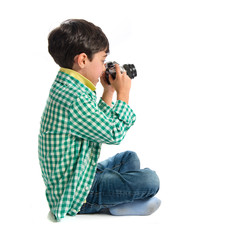Boy photographing something over white background