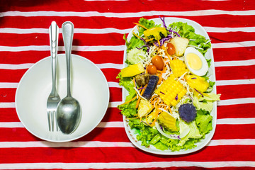 Vegetables and fruits salad with boiled egg