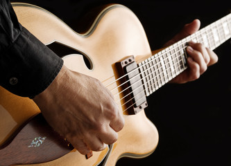 Wall Mural - playing custom jazz guitar