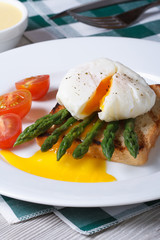 Toast with asparagus, eggs Benedict and tomato vertical