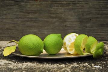 green lemmons on a platter