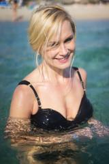 beautiful blonde woman swimming in the ocean