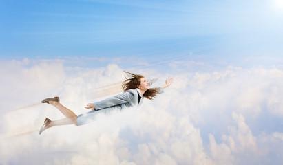 Flying businesswoman