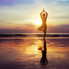 yoga on the beach, healthy lifestyle concept
