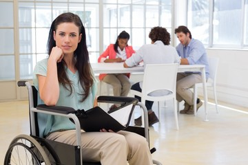 Attractive disabled businesswoman at work