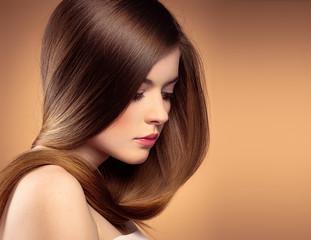 Beautiful teenage girl with healthy straight long hair