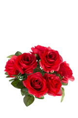Bouquet of artificial red roses, isolated, space for copy on the