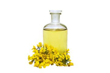glass bottle of rape seed oil with rape flowers