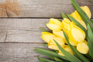 Obraz Fresh yellow tulips over wooden table - fototapety do salonu