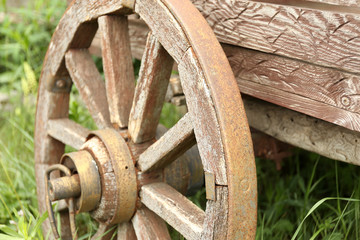 Old retro wheel on trolley, outdoors
