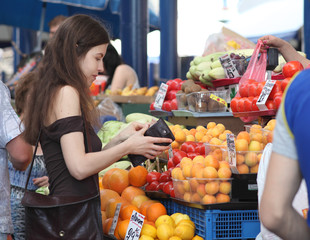 Shopping at the market. Woman is buying fruits on a market.