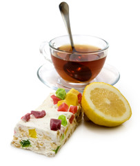 isolated image of cup of tea and cake closeup