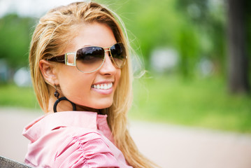 Portrait of Young Woman with Sunglasses