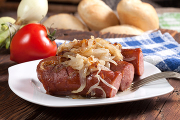 Fried sausage with onions.