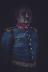 Uniform, old soldier style jacket with blue and gold epaulettes,