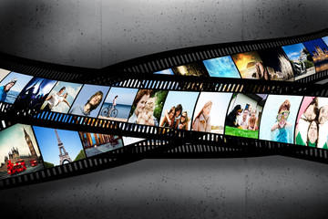 Film strip with vibrant photographs on grunge wall