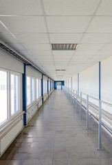 Long corridor with door at end.