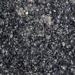 Pieces of broken bitumen asphalt
