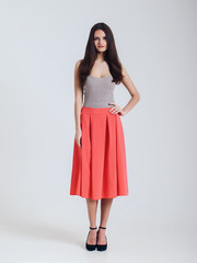Girl in beautiful skirt. red