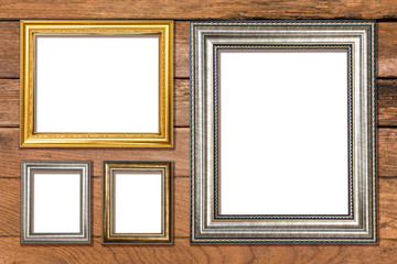 Gold frame on old wooden background