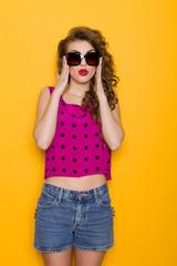Surprised beautiful woman in sunglasses
