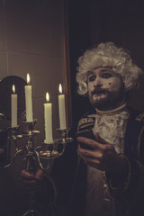 Selfie, man with white wig nineteenth and candlestick with candl