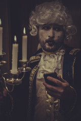 Selfie, man with smartphone, white wig and candlestick nineteent