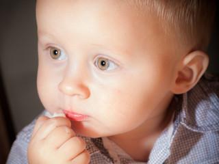 Cute baby boy eating something