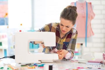 Seamstress sewing in studio