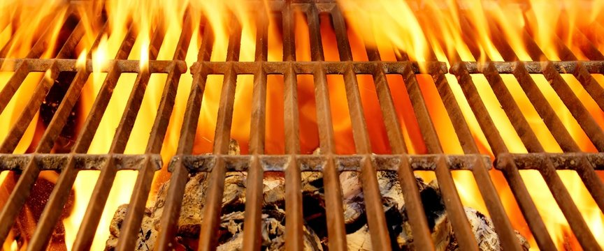Hot BBQ Grill and Burning Charcoals with Bright Flame