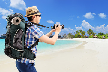 Tourist taking picture at a sandy beach
