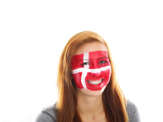smiling girl with danish flag painted on her face