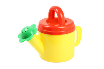 small watering can watering flowers on a white background