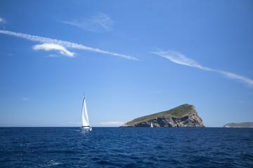 Sailing yachts with white sails in the sea. Luxury yachts.