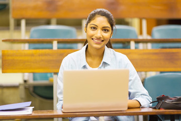 female indian college student using a laptop