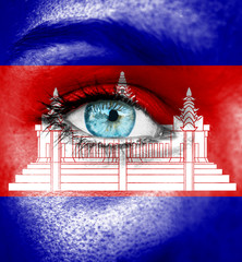 Woman face painted with flag of Cambodia