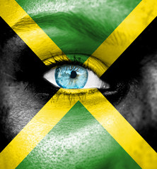 Woman face painted with flag of Jamaica