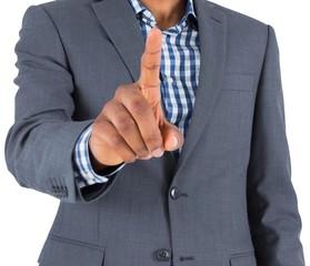 Focused businessman pointing