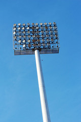 Stadium light pole in the sky.