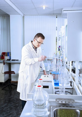 Laboratory assistant works in chemical laboratory