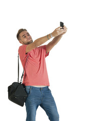 Young handsome guy taking selfie with mobile phone camera