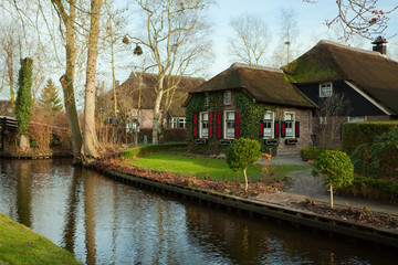 Traditional Dutch house with  thatched roof , Giethoorn, Dutch .